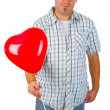 Young man with red heart ballon — Stock Photo