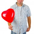 Young man with red heart ballon — Stock Photo #8785682