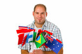 Jonge man met internationale vlaggen — Stockfoto