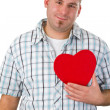 Young man holding red heart — Stock Photo