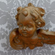 Carved wooden angel - Stock Photo