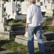 Woman walks through an cemetery — Stock Photo