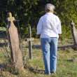 Woman walks through an old cemetery — Stock Photo