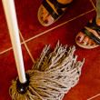 Woman cleaning a tiled floor — Stock Photo