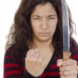 Aggressive young woman with a clenched fist and a kitchen knife — Stock Photo