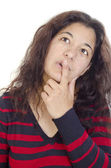 Thoughtful young woman and the index finger on her lips — Stock Photo