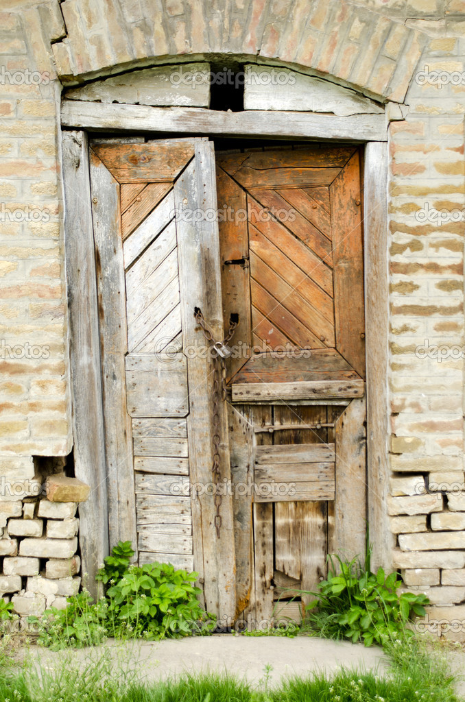 Dilapidated old wooden door in a shed  Stock Photo #10212456