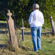Woman walks through an old cemetery — Stock Photo #10278681