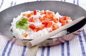 Rice pan with diced red bell pepper — Stock Photo