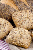 Multigrain roll and poppy seed bread — Stock Photo