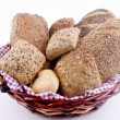 Basked with fresh rolls and freshley baked bread — Stock Photo