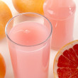 Red grapefruit and juice in a glass — Stock Photo