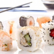 Sushi and soy sauce in the background — Stockfoto #8025054