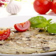 Omelette with mushrooms and basil on a plate - Stock Photo