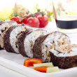 Sushi and soy sauce in the background - Stock Photo