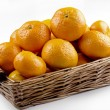 Stock Photo: Tangerines in brown wicker basket