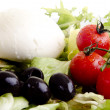 Mediterranean salad with mozzarella, olives and tomatoes - Stock Photo