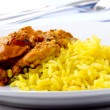 Chicken tikka masala with curry rice - Stock Photo