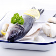 Sea ​​bass in an enamel bowl - Stock Photo
