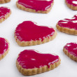 Heart-shape cookie with strawberry icing - Lizenzfreies Foto