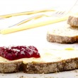 Home made bread spread with cranberry jam — Stock Photo #8599626