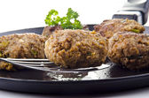 Freshly fried meat balls lying on a pan — Stock Photo