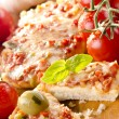 Stock Photo: Small pizzas with peppers and cheese gratin