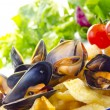 French fries with mussels, a Belgian specialty — Stock Photo