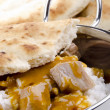 Chicken goulash with rice and naan bread - Stock Photo