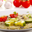 Omelette with courgette and tomato — Stock Photo