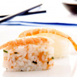 Sushi and soy sauce in the background — Stock Photo