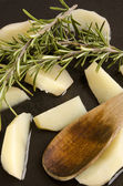 Potato wedges are fried with rosemary — Stock Photo