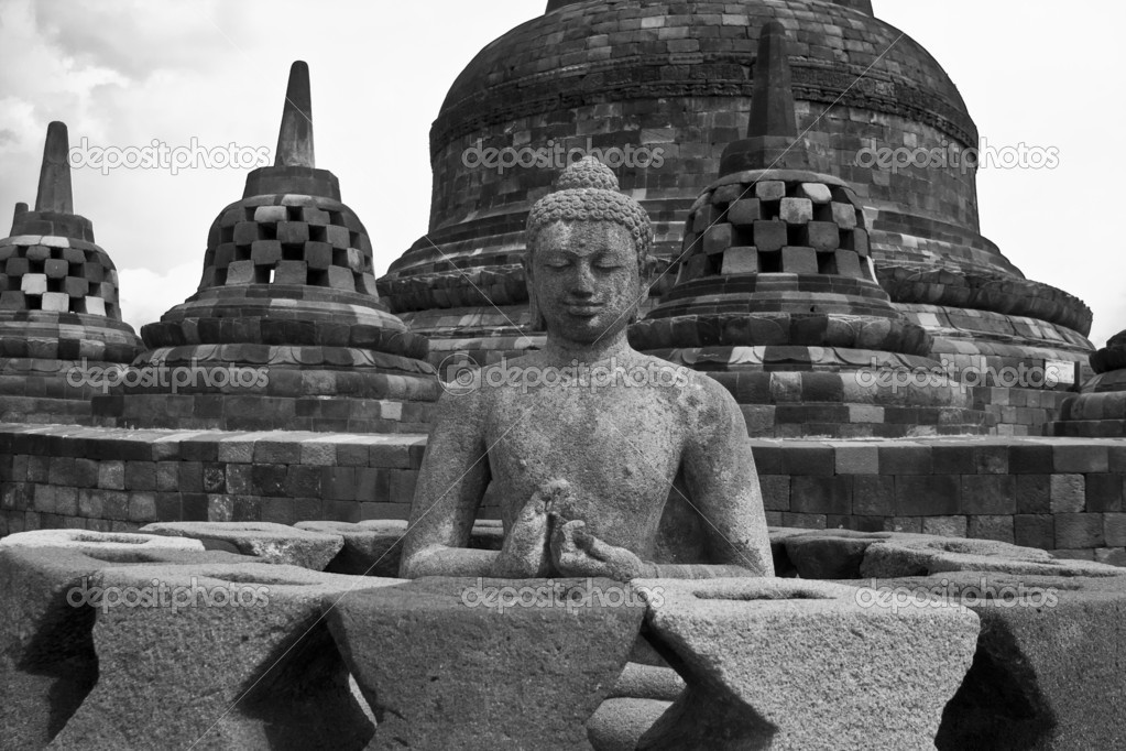 Stone statue of buddha in a buddhist temple of borobudur, indonesia — Stock Photo #9618800