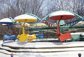 Carousel under the snow — Stock Photo