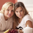 Mother and daughter have breakfast — Stock Photo
