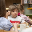 Stock Photo: Lunch in the kindergarten
