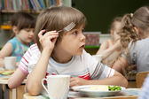 Little boy has a lunch — Stock Photo