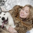 Stock Photo: Portrait of young womwith malamute
