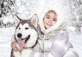 Malamute dog with a girl — Stock Photo