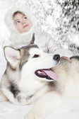 Malamute puppy with a little girl — Stock Photo