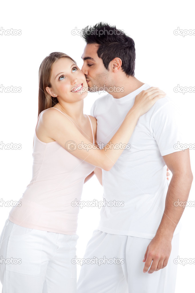 Portrait of young man kissing the young woman isolated on white background.  Stock Photo #10021535
