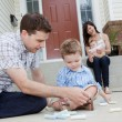 Father And Son Drawing With Chalk on Sidwalk — Stockfoto