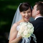 Groom Kissing Bride on Ear — Stock Photo