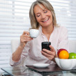 Stock Photo: Mature Woman Using Phone
