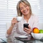 Mature Woman Using Phone — Stock Photo