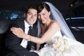 Happy Wedding Couple in Limo — Stock Photo