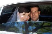 Wedding Couple in Limousine — Stock Photo