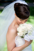 Portrait Of Young Bride With Bouquet — Stock Photo