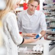 Pharmacist Helping Customer — Stockfoto #8811827
