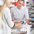 Pharmacist Helping Customer — Stock Photo